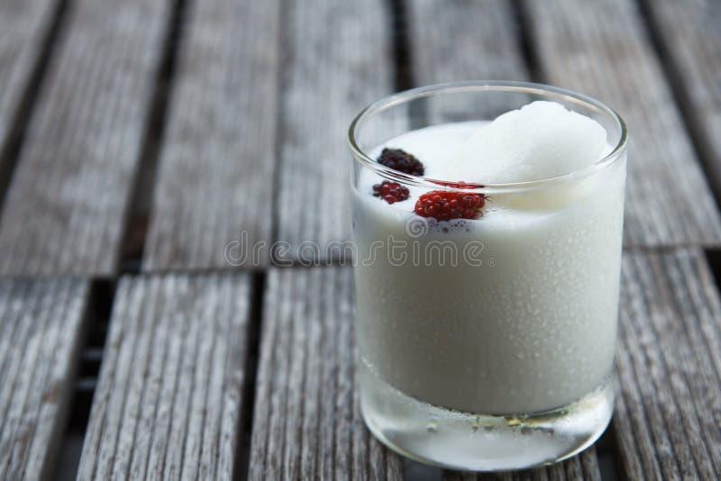 Glass of delicious icecream milkshakes royalty free stock photography