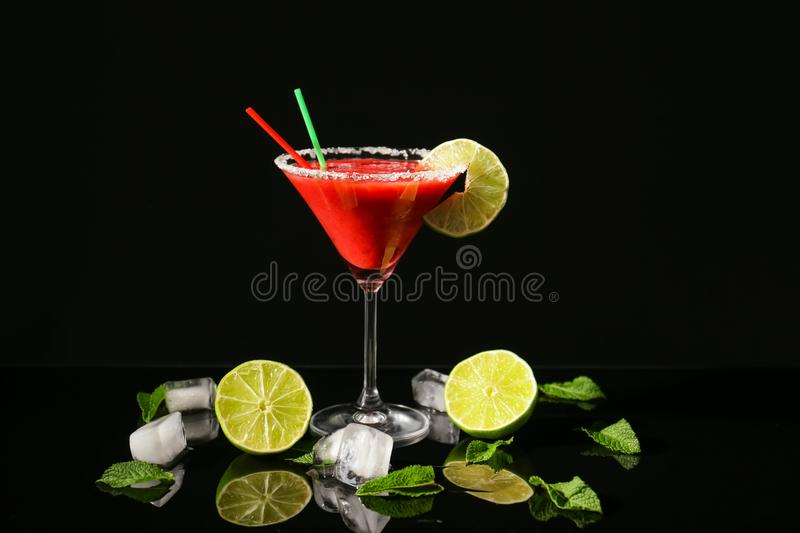 Glass of delicious strawberry daiquiri with lime royalty free stock images