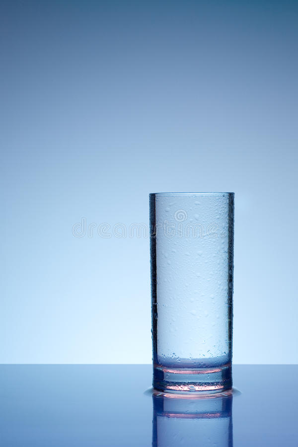 Glass with dew drops. Glass of cold water with dew drops stock image