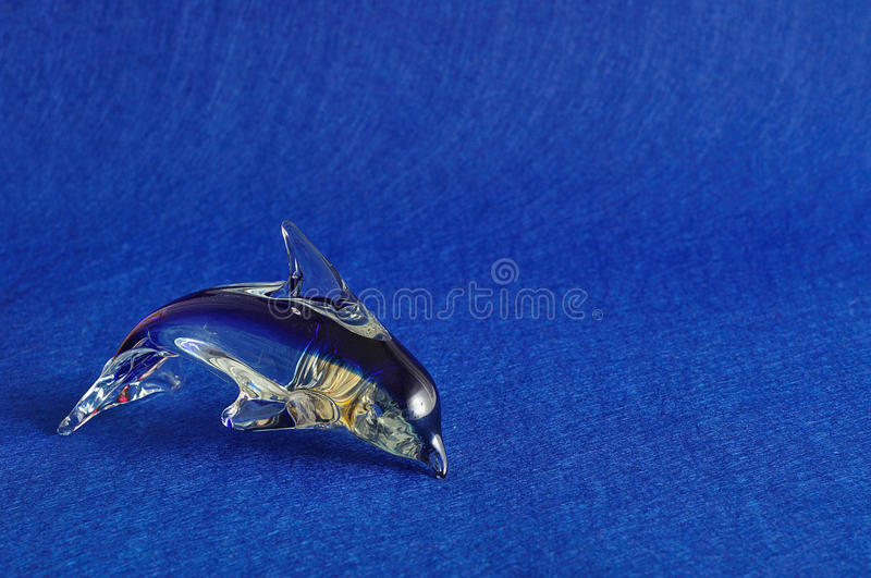 A glass dolphin figurine. That is sold for souvenirs at various gift shops stock photos