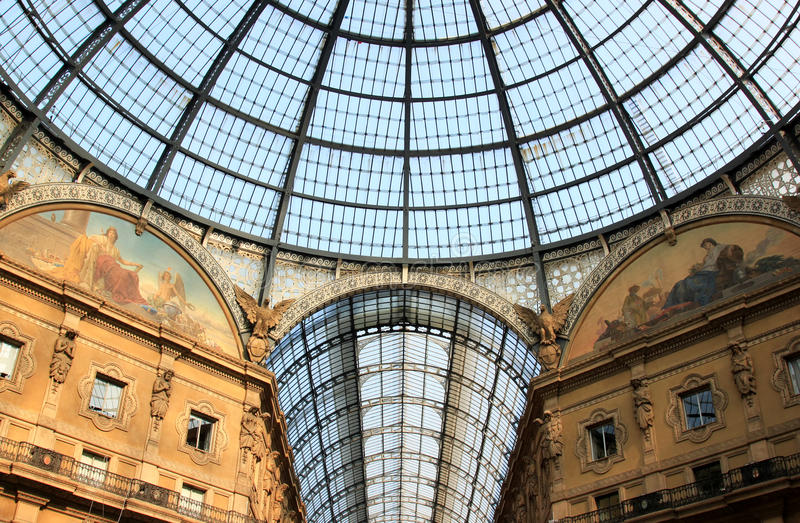 Glass dome of Galleria Vittorio Emanuele II, Milan. The Galleria Vittorio Emanuele II is one of the world's oldest shopping malls, housed within a four-story stock photo