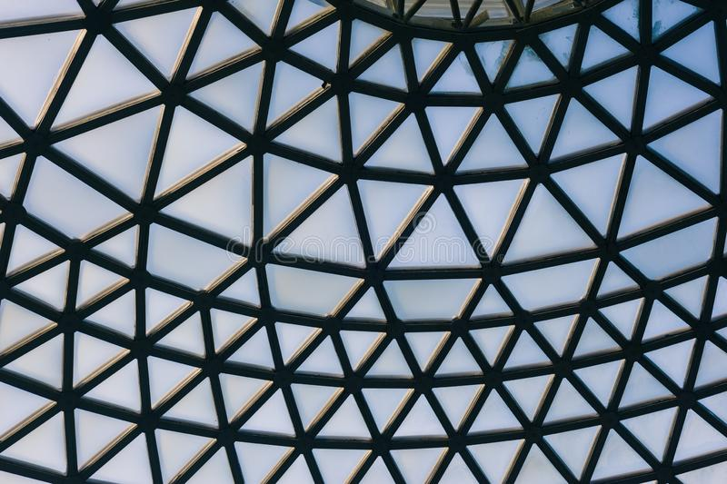 Glass domed roof of a tropical garden royalty free stock images