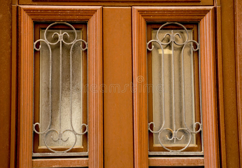 Glass in the door. Carvings the glass of the entrance door stock photography