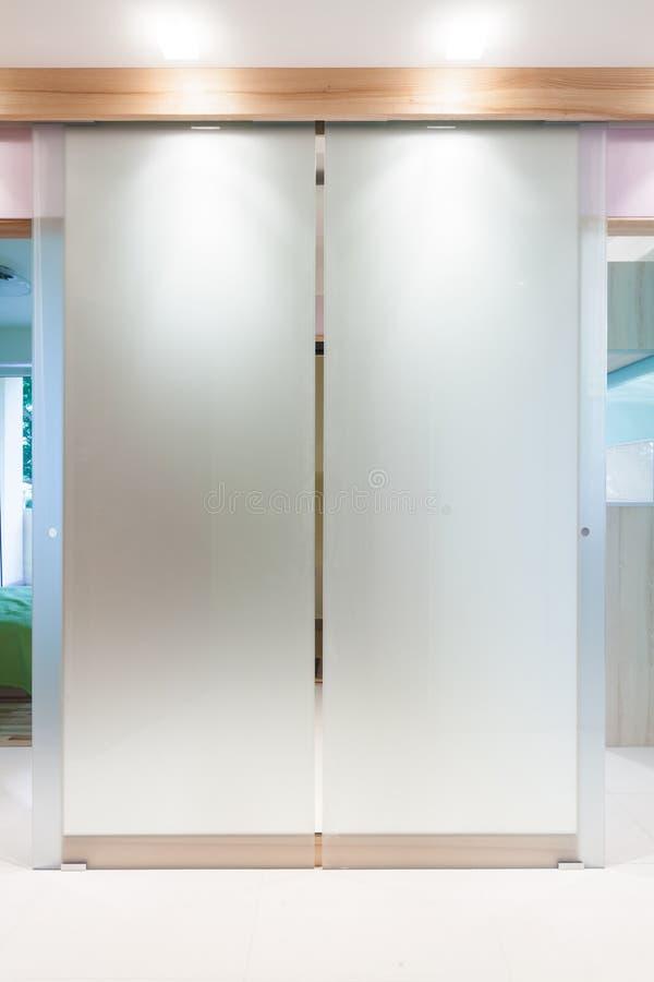 Glass door in modern apartment stock photos