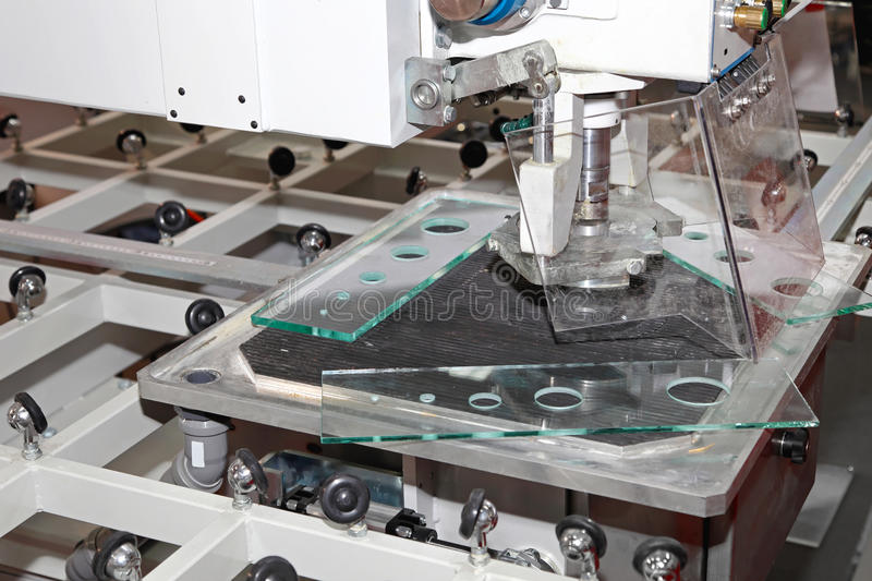 Glass drilling machine. Table in factory stock image