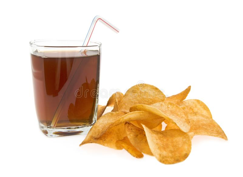 Glass with drink and chips stock photo