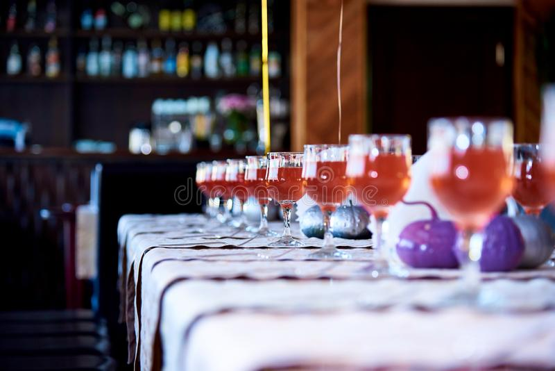 A glass of drink on a serve table. royalty free stock photo