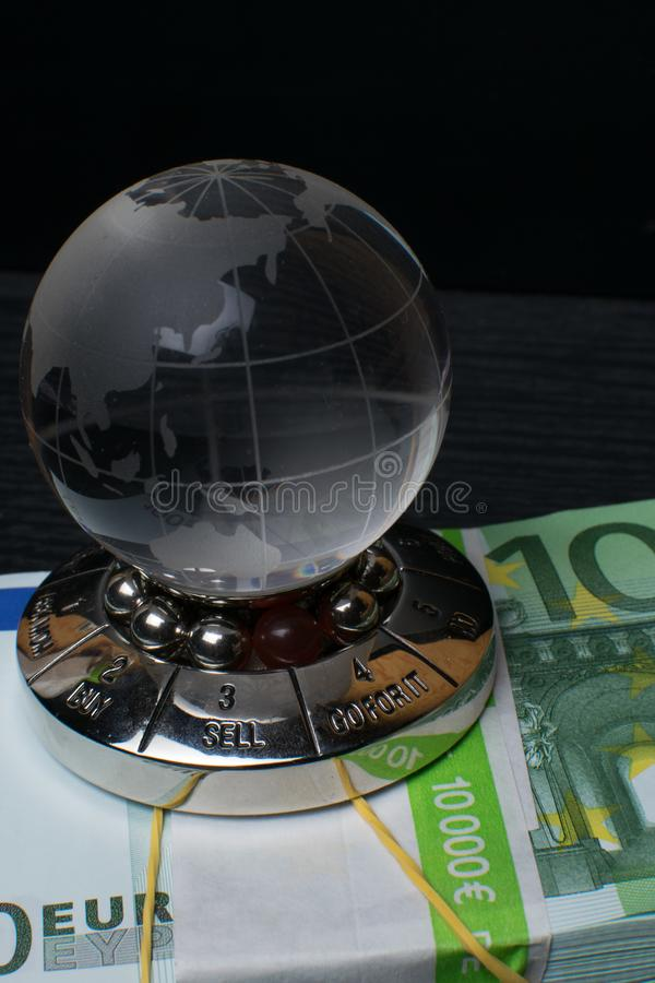 Glass earth with choice and big amount euro cash on the black wooden background. Glass earth with choice and big amount euro cash 500, 100 on the black wooden stock images