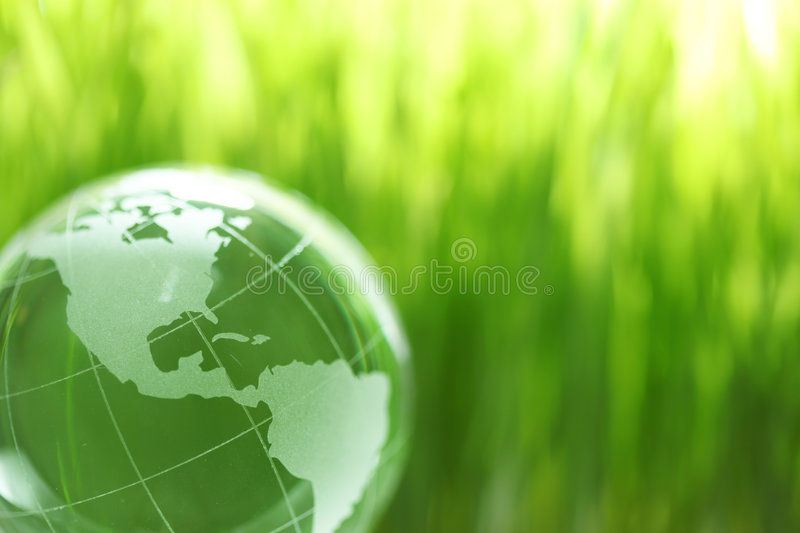 Glass earth in grass royalty free stock image