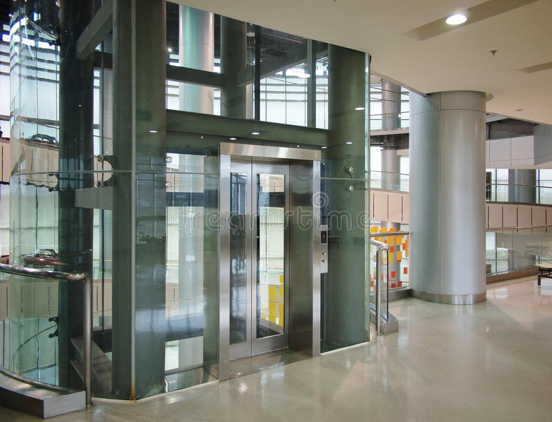 Glass elevator stock photo image of corporate exhibition for Ascenseur pour maison prix