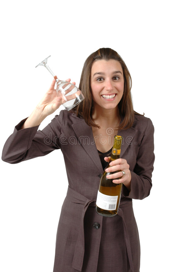 The Glass Is Empty. Business woman holds wine glass upside down to show glass is empty and she is ready for happy hour. Vertical crop on white background royalty free stock images