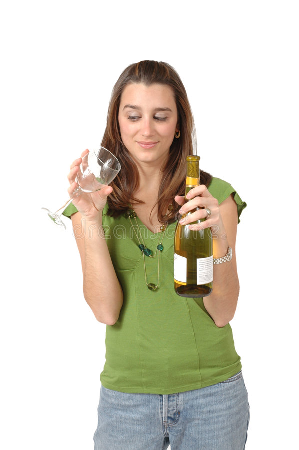 Glass is Empty. Young twenty something woman stares down at the empty wine glass, while she holds a bottle of wine. Ready fro Happy Hour? Contemplating drinking stock images