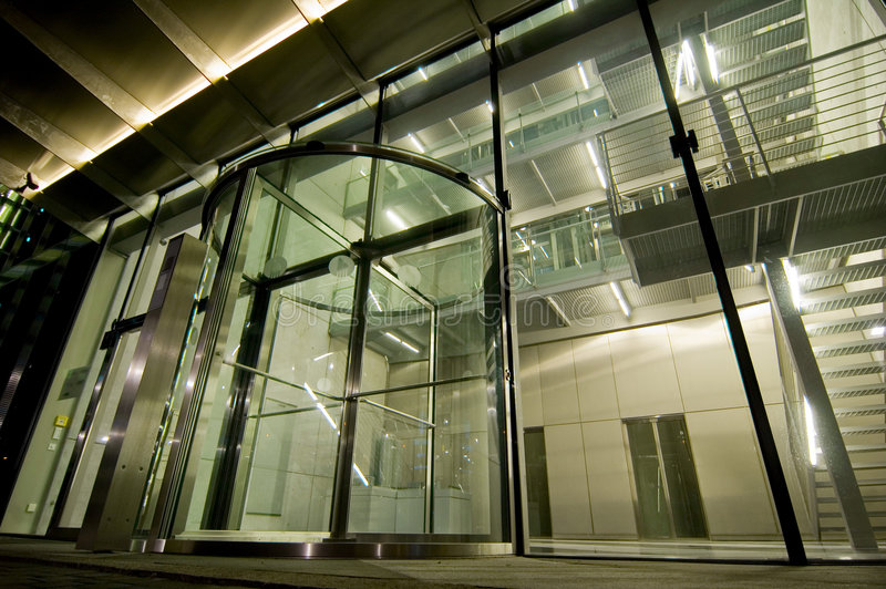 Glass Entrance to a Modern Building. All-glass entrance and doorway to a large modern office building royalty free stock image