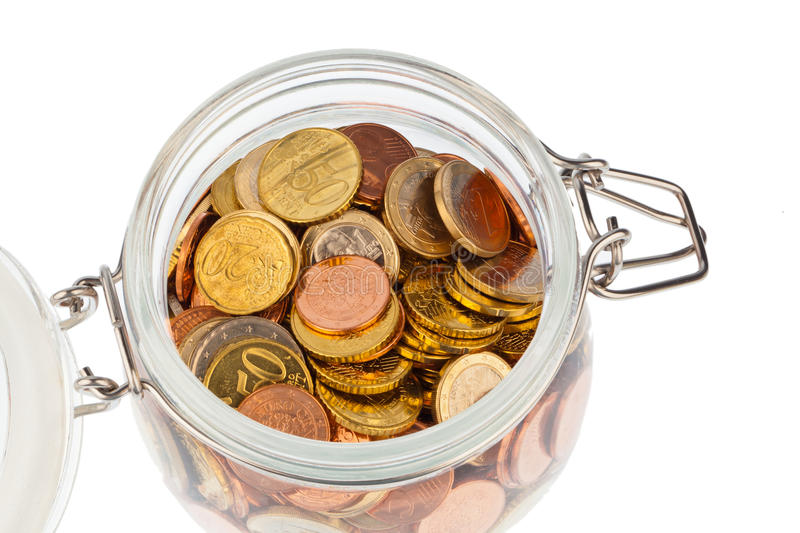 Glass with Euro coins royalty free stock image