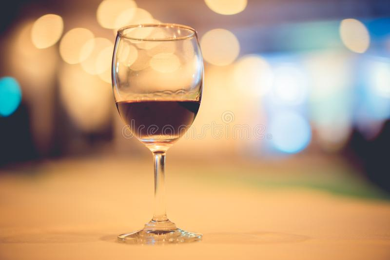 glass of expensive wine at a luxurious dinner. stock photo