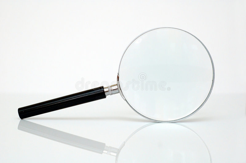 glass förstoring arkivfoto