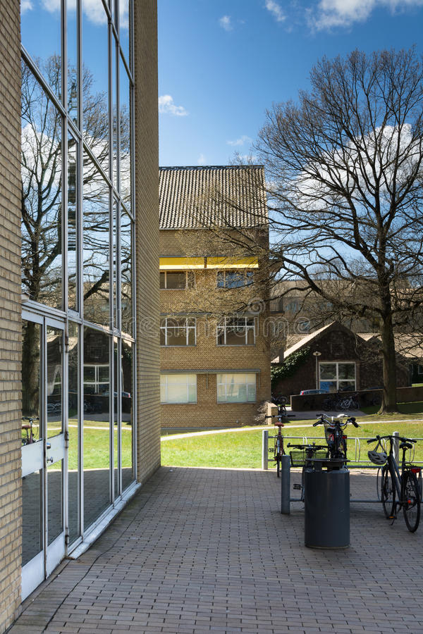 Glass facade - Aarhus University, Denmark. The architecture of Aarhus University is made up of glass and brick facades, clay tile squares and perfect integration stock photo