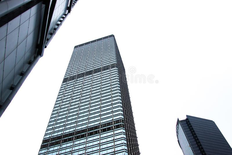 Glass facade business building bottom view in Hong Kong city. Office building and skyscrapers facade with glass window stock photo