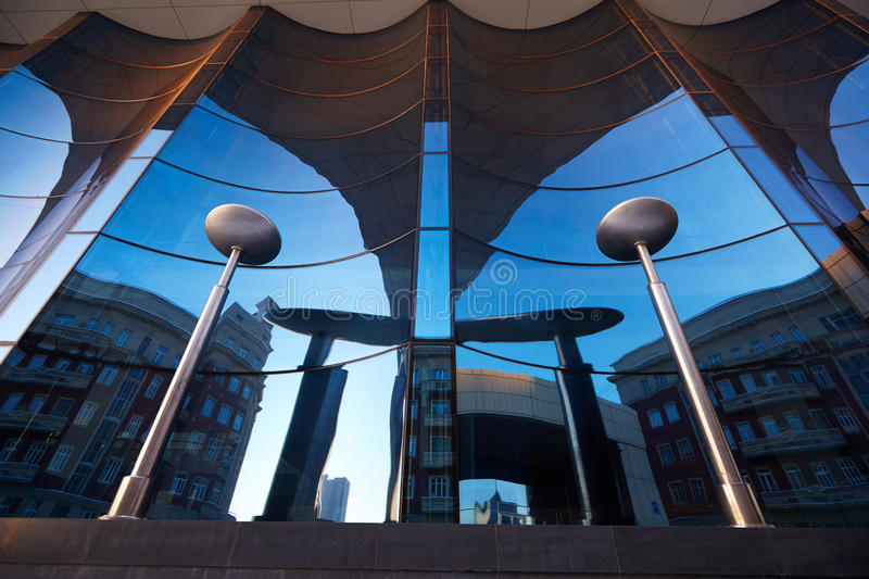 The glass facade of curved blue glass.  royalty free stock photo