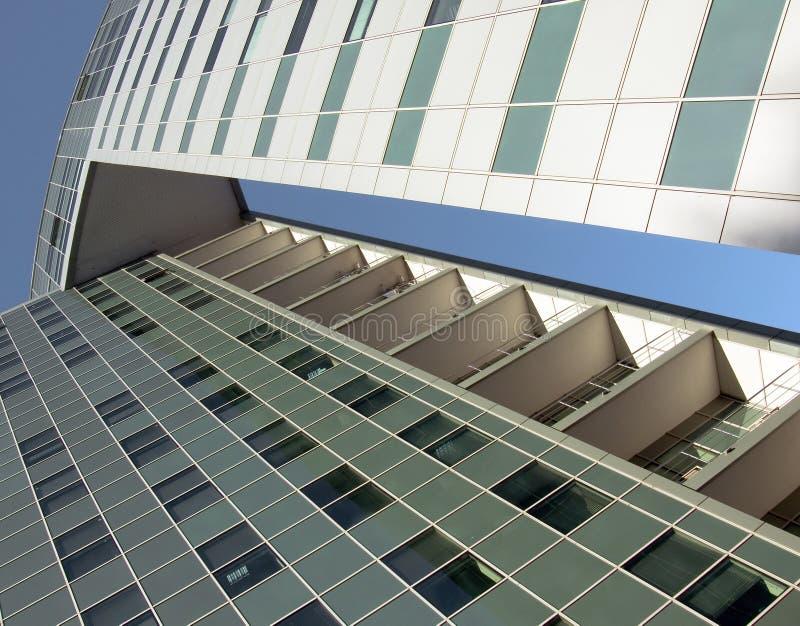 The glass facade of a skyscraper stock image