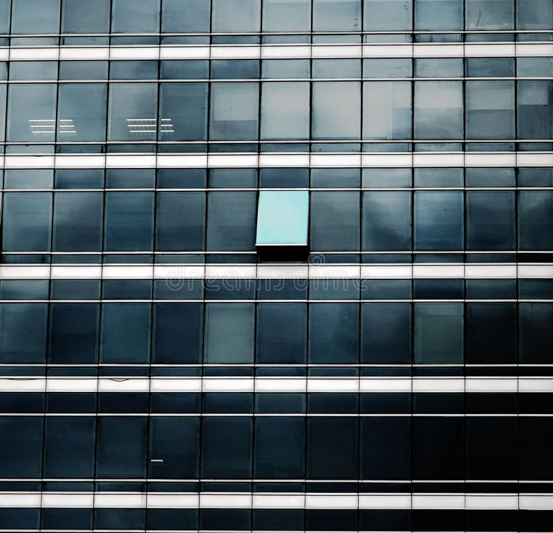 The glass facade of skyscraper with many identical windows royalty free stock image