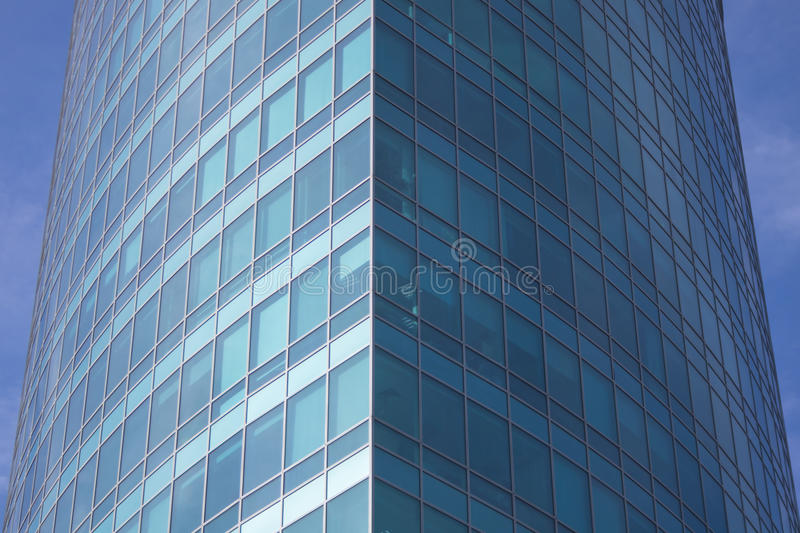 The glass facade of a skyscraper with a mirror reflection of sky windows. Photo stock image