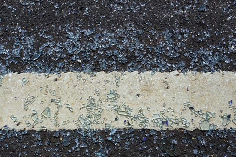 Glass falls on the road and broken. The shattered glass was spread out on the road. It be come dangerous must be careful while dri royalty free stock photography