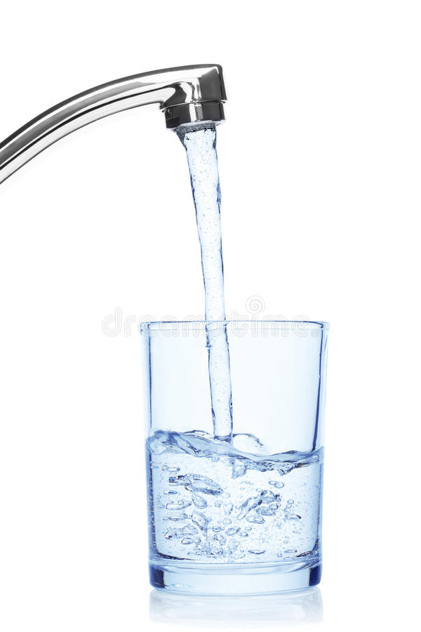 Glass filled with drinking water from tap. royalty free stock images