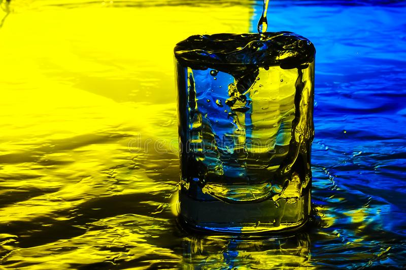 the glass is filled with water royalty free stock image