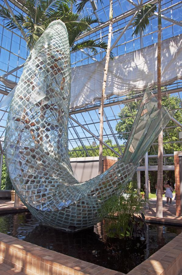 A glass fish sculpture at the sculpture garden royalty free stock images