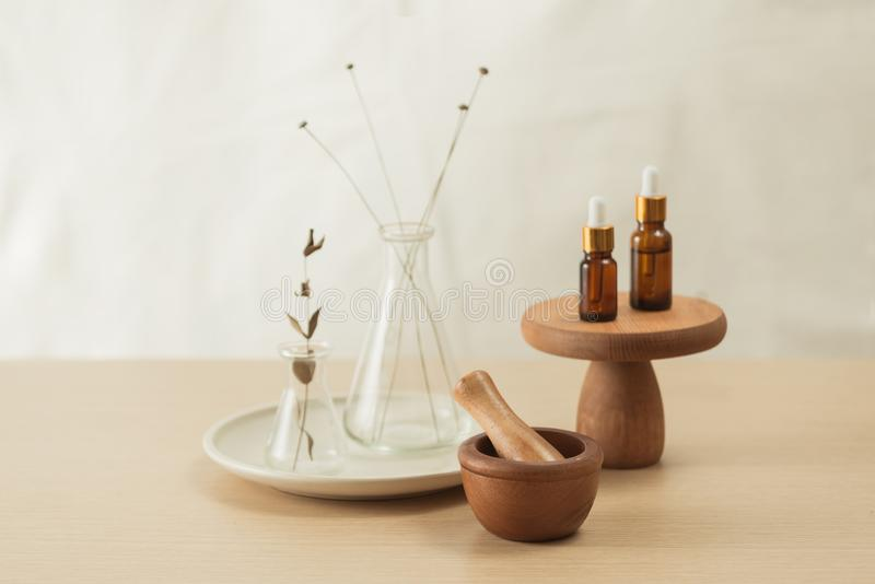 Glass flask and test tubes with flowers for medical health or cosmetic science research laboratory stock photography