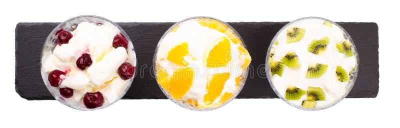 Glass från körsbäret från en kiwi från apelsinen arkivbilder