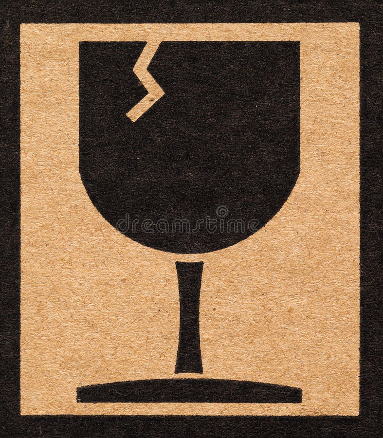 glass of fragile symbol on cardboard stock photo