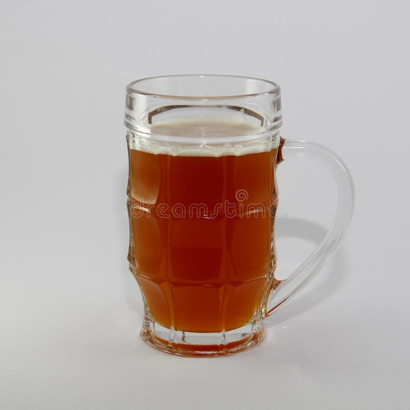 A glass of fresh beer stock photo