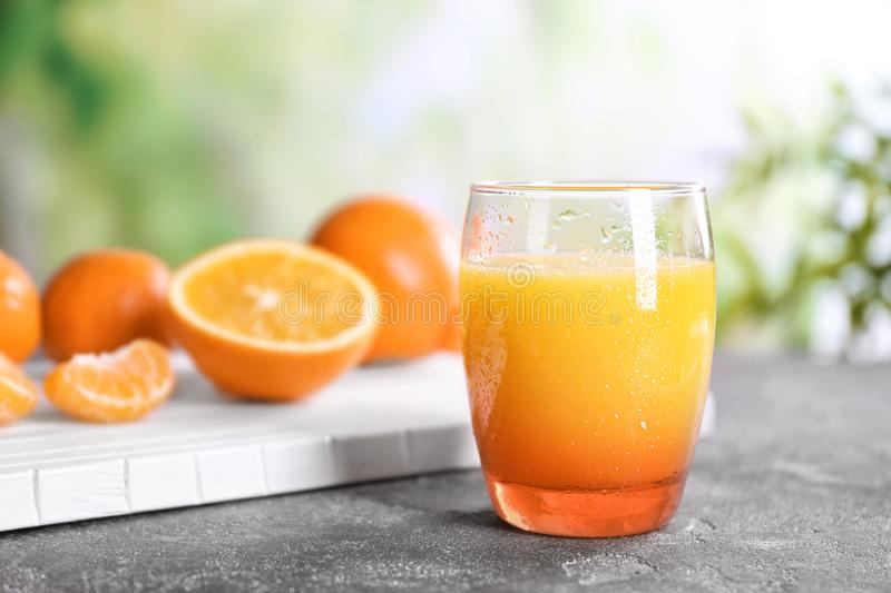 Glass with fresh citrus juice. On table royalty free stock photography