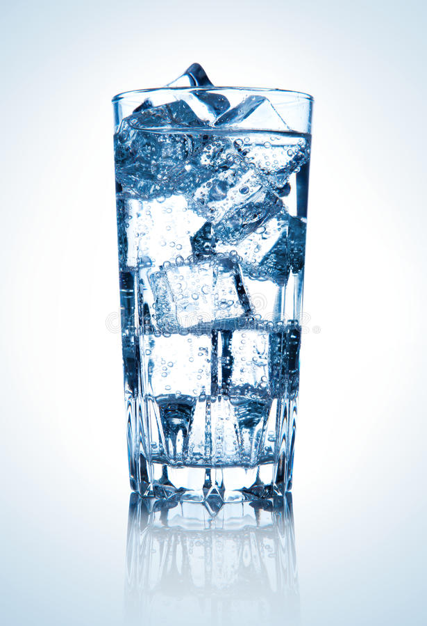Glass of fresh cool water with ice royalty free stock photography