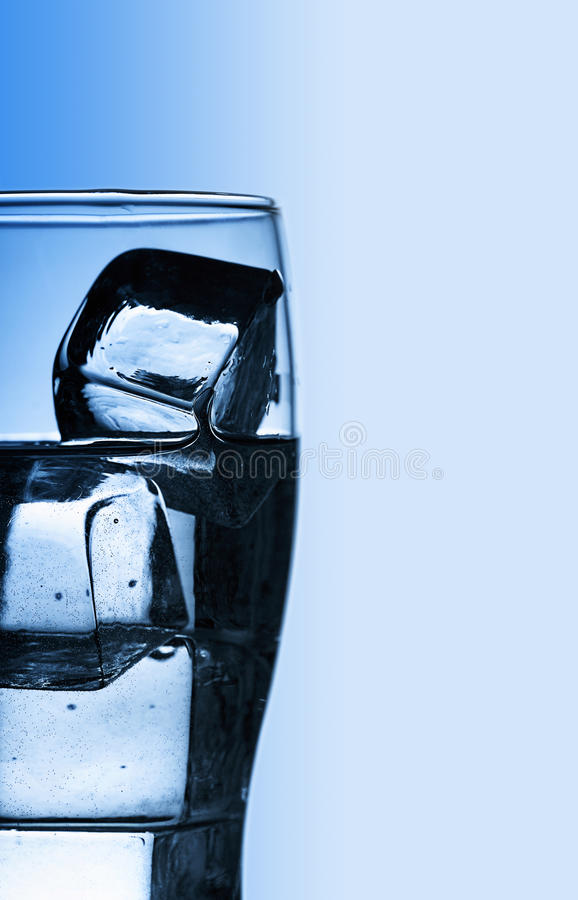 Glass with fresh cool water and ice royalty free stock photography