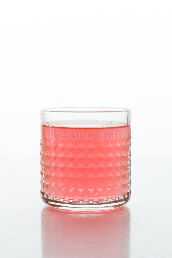 A glass of fresh drink. Trendy color 2019, living coral stock photos