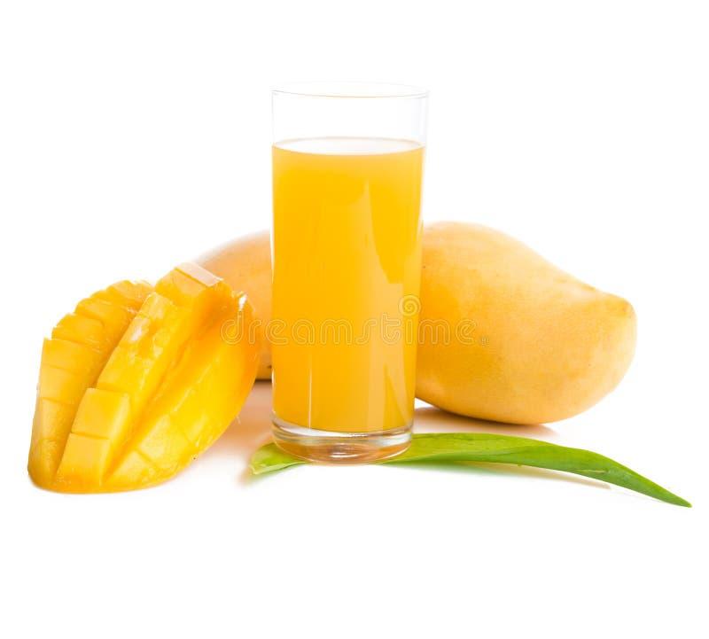 Glass of fresh mango smoothie stock image
