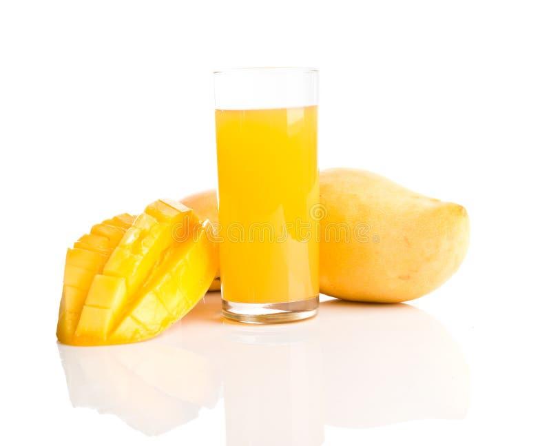 Glass of fresh mango smoothie royalty free stock images
