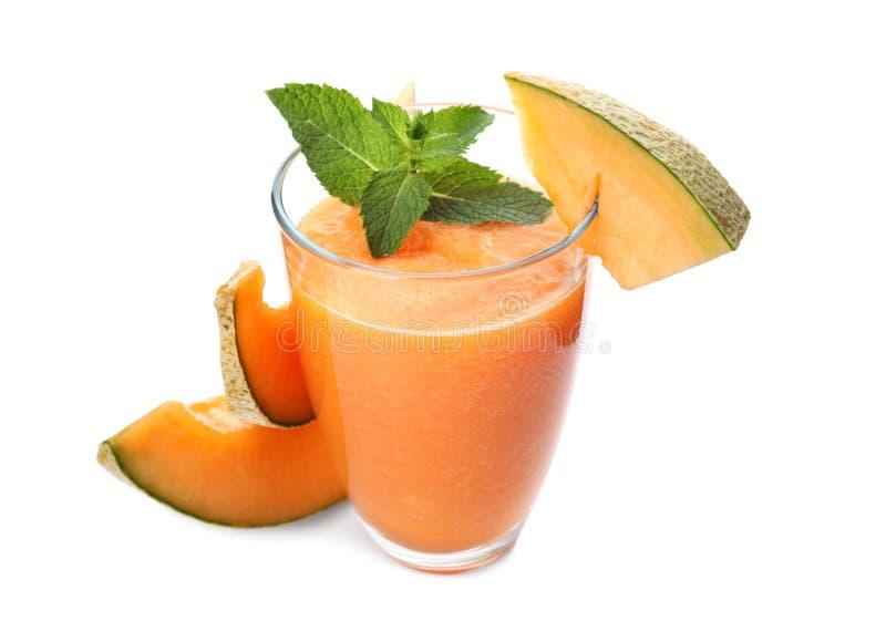 Glass of fresh melon smoothie on white background royalty free stock photo