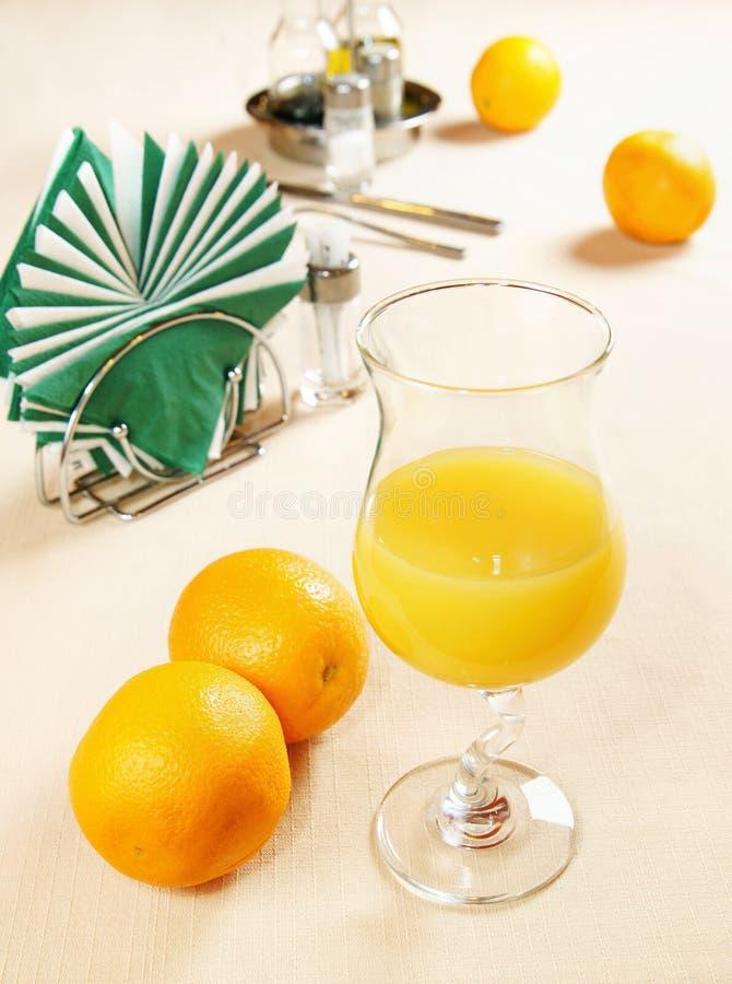 Glass of fresh squeezed orange juice stock image