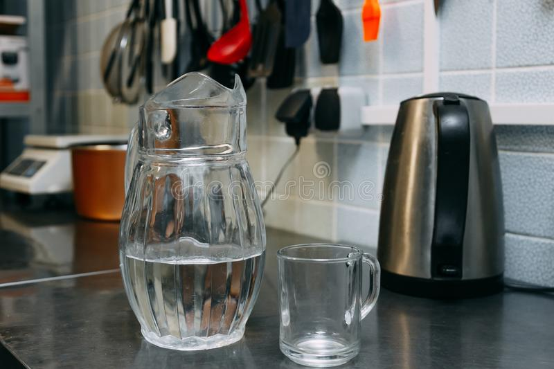 A glass of fresh water with crafin on the background of a modern kitchen stock photography