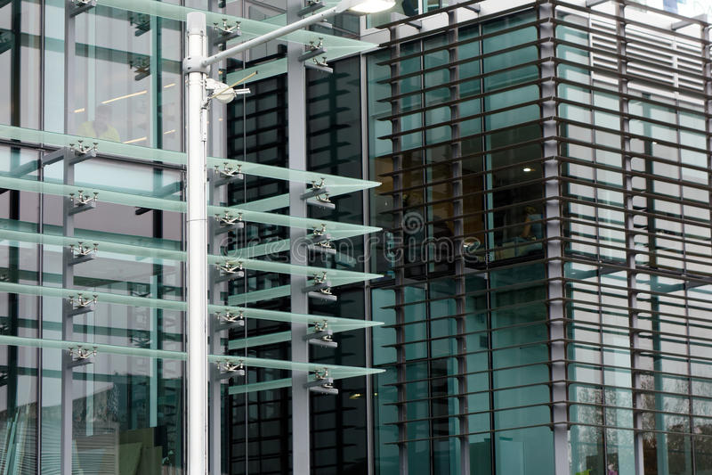 Glass Fronted Modern Building. Graphic glass fronted and louvered modern multi level commercial building royalty free stock photography