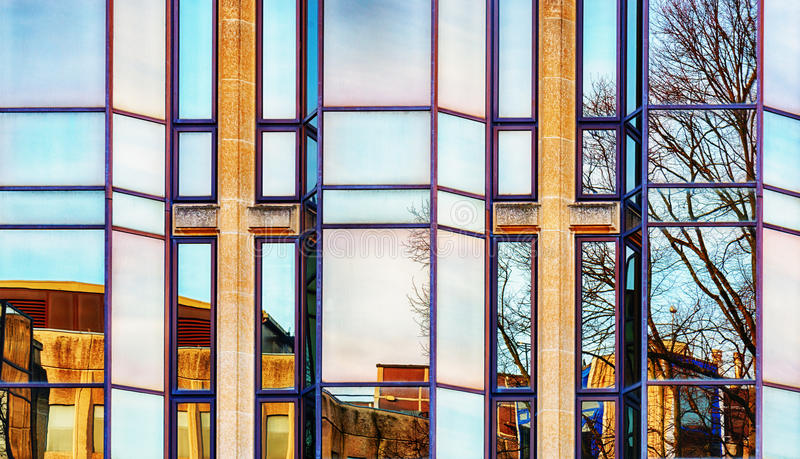 Glass fronted office block. Reflection in a modern glass fronted office block stock photos