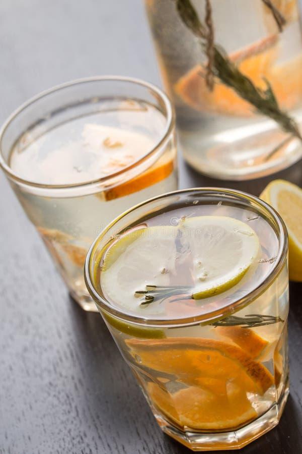 Glass of frozen homemade lemonade. With rosemary stock images