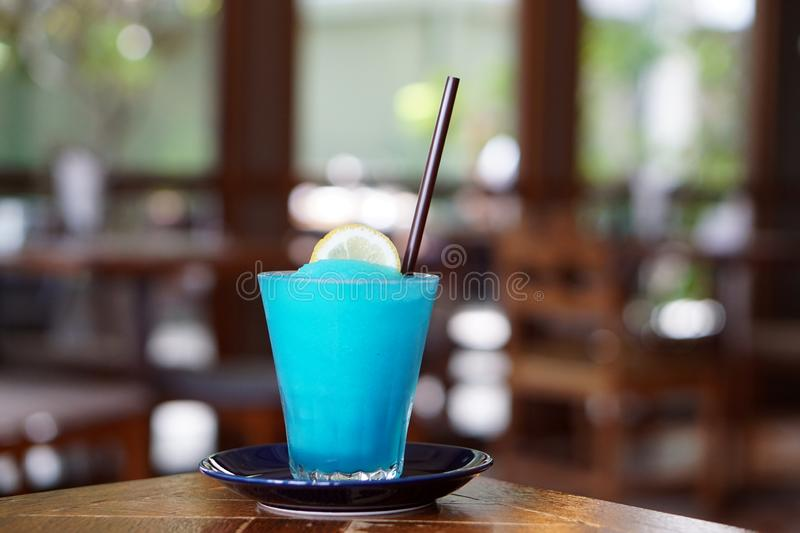 A glass of Frozen margarita cocktail with lime juice, blue grenadine and soda. A glass of Frozen margarita cocktail with lime juice, blue grenadine and soda on royalty free stock images