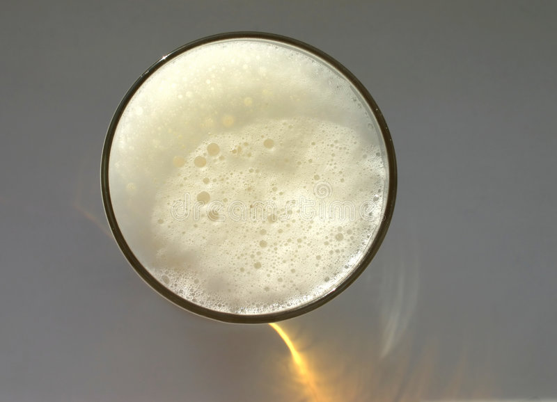 Glass full of beer, view from obove royalty free stock images