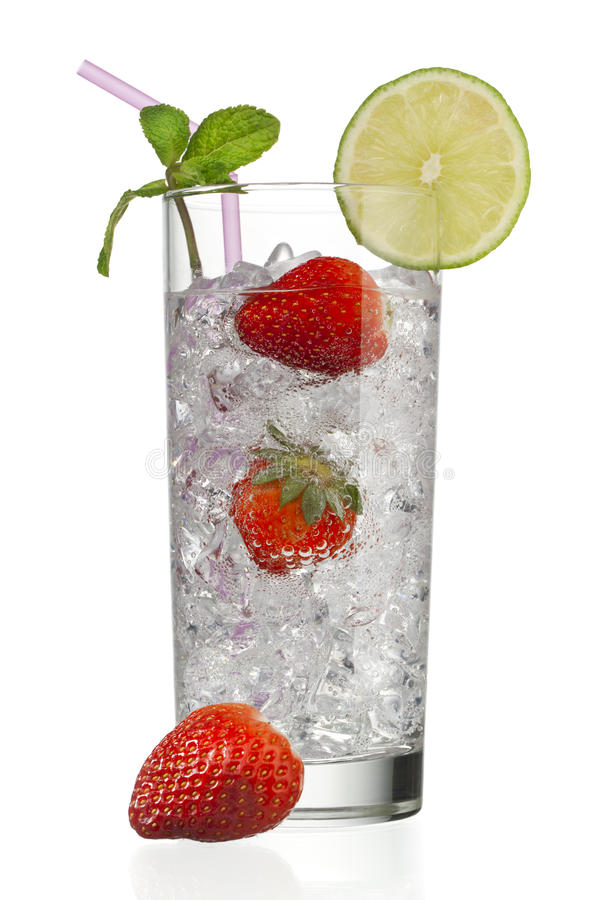 Glass full of ice cubes with strawberries and decorated with lemon royalty free stock photo