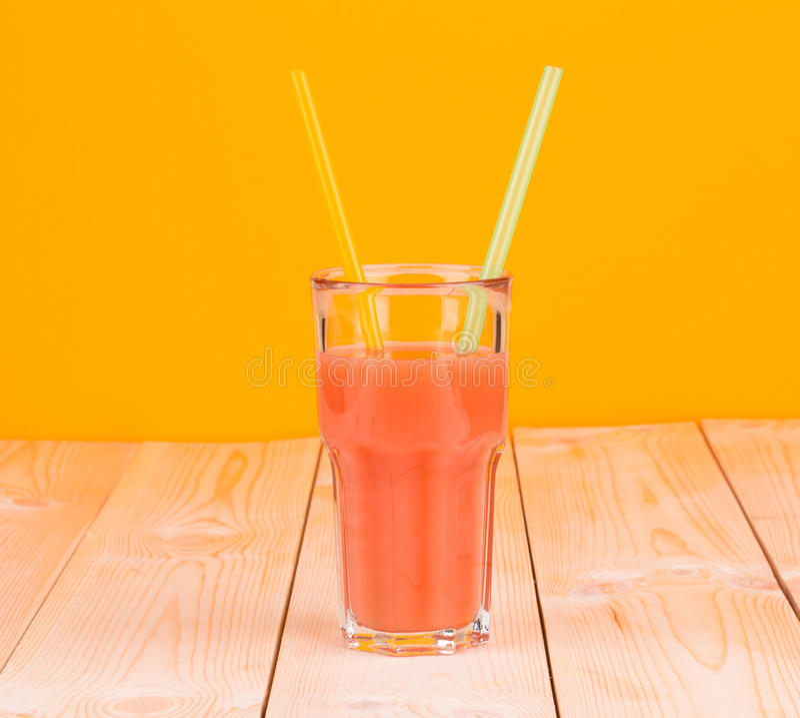 Glass full of tasty fresh grapefruit juice. stock photography